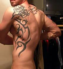 Amazing Tribal Design For Your Back A Bold Hand And Shoulder Tattoo