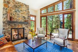 Rustic Living Rooms Room With Stone Wall Glass Fireplace Doors