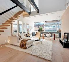 loft with awesome staircase and bleached floorbards