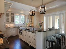 uba tuba granite kitchen traditional with barstools ceiling lights