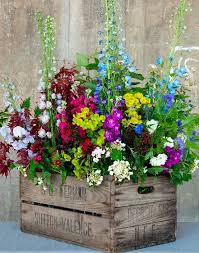 Flowers Fill A Vintage Wooden Crate