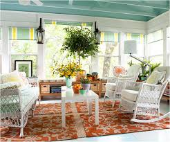 Sunroom Furniture Ideas With Padded Chairs Two Square White Tables On Floral Rug Under Wallsconces Ceiling Fan And Wooden Exposed Beam