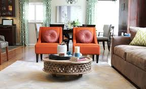 orange transitional chairs and rustic coffee table traditional