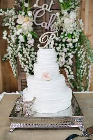 4 Tier White Wedding Cake On Square Stand With Two Metal Love Bird Figures
