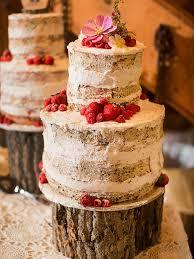 Natural Rustic Wedding Cake With Floral And Berry Decorations