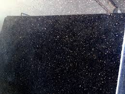 A Close Up Photo Of Black Galaxy Granite