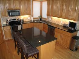 Kitchens With Dark Cabinets And Light Countertops by Light Floors Dark Cabinets Yellow Pendant Lamps What Countertop
