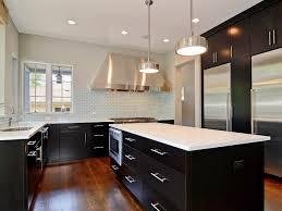 appliances pale blue tile backsplash with varnished oak flooring