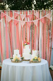 Outdoor Coral Wedding Decor Ideas With Tulle And Round Table Also Three Tiers Cake
