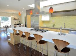 tile vs wood kitchen midcentury with yellow tile backsplash wood