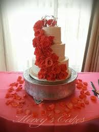 Buttercream Wedding Cake With Coral Roses By Honeys Cakes The Textured Horizontal Lines Add A