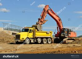 Large Track Hoe Excavator Loads Dump Stock Photo (Edit Now ... Large Track Hoe Excavator Filling A Dump Truck With Rock And Soil Train Strikes Dump Truck In Taylorsville 2015 Rayco Rct80 New Kubota Diesel Made In Usa Two Trains Hit Killing Driver Morooka Mst1100 Crawler Carrier 5 Ton Capacity Haul Wikipedia Jellydog Toy Tumble Set Car Twister Electric Injured When Flips Near Weymouth Train Tracks News Tracked All Nodwell At Pioneer Rentals Dumptruck