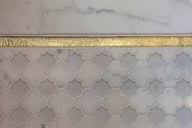 gold tile trim design ideas