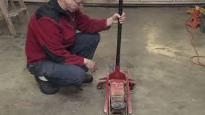 car maintenance how does a floor jack work youtube