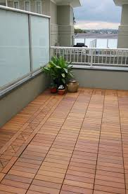 ipe wood deck tiles on a small condo balcony contemporary