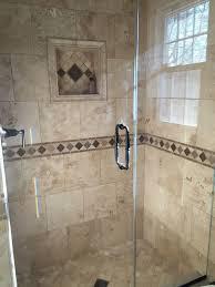 travertine tile shower on bottom then accent liner then