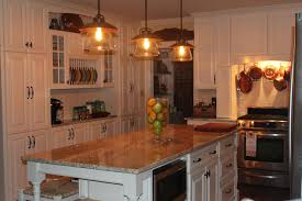 love the lights copper pots above the stove the counters and