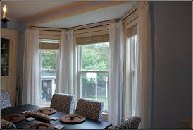 Arched Or Curved Window Curtain Rod Canada by How To Hang Curtains In A Bay Window Modelismo Hld Com