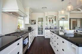 Luxurious White Kitchen Designs Combine Dark Alluring Wooden Floor Black Granite Countertop Upper Also Lower Cabinets Storage Modern