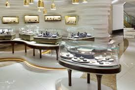 Gold Finished Pendant Lamps And Fascinating Display Cases For Luxury Jewellery Shop Design