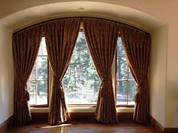 Curved Curtain Rod For Arched Window Treatments by Curved Window Curtain Rod Installation