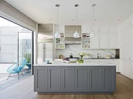 gray island with marble countertop white cabinets with side by