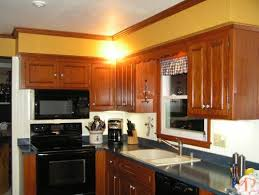 i would like to paint our kitchen soffits to update the mustard