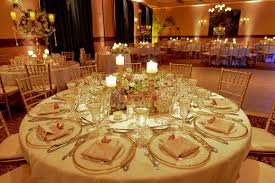 Candle And Red Rose Arrangement On Grey Table Cloth For Wedding Centerpiece