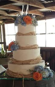 A Beautiful Rustic Wedding Cake For My Friend Finished With Raffia Ribbon Blue Hydrangea And Coral Roses