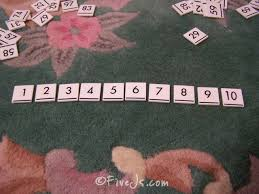 how to teach counting and basic math concepts with number tiles