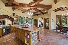 rustic kitchen with terracotta tile floors high ceiling in