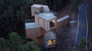 100 Tree House Studio Wood Stacked Boxes Form Bengo S Towering Hotel