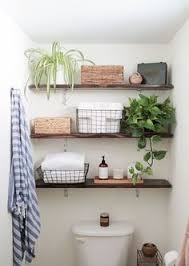 20 Thin Dark Stained Wooden Floating Shelves For Storing Bathroom Things