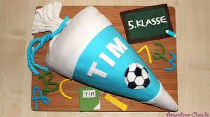 einschulungstorte schultüte mit süßigkeitenfach kinderschoki ganache piñata torte