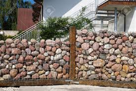 100 Gabion House Fence Between The House And The Garden Made Of Pebble Stones