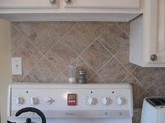 kitchen backsplash rev using peel and stick vinyl tiles