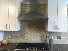 khaki glass subway tile kitchen backsplash with custom accent