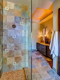 mediterranean bathroom with wooden vanity cabinets and