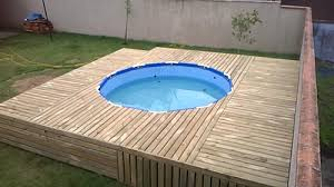 You Can Construct Pretty Much Anything With Pallets Pool Included This DIY Uses Heat Treated Deconstructed Wood To Form The Deck And Has A