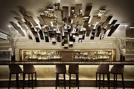 Two Restaurants Jean Georges Kitchen A Casually Chic Open Dining Room Sophisticated And Refined Linked By Magical Reflective