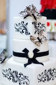 Beautiful white and black butterfly wedding cake Stock