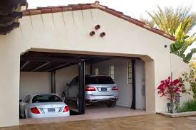 Custom car lift in California garage Mediterranean Garage