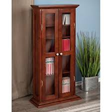 amazon com winsome wood cd dvd cabinet with glass doors antique