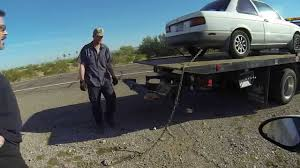 Nissan Sentra On A Flatbed Tow Truck, AAA Rescue, Ironwood Towing ...