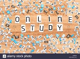online study words from cut out letters on wooden table Stock