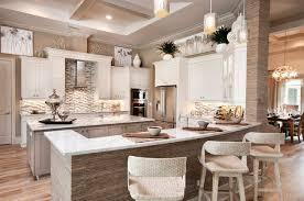 Inspiration For A Beach Style U Shaped Light Wood Floor Kitchen Remodel In Miami With