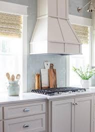 light blue subway tile kitchen backsplash transitional kitchen