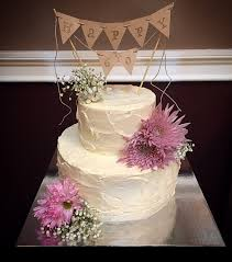 60th Birthday Cake Rustic Looking Italian Buttercream Adorned With Fresh Flowers And Topped