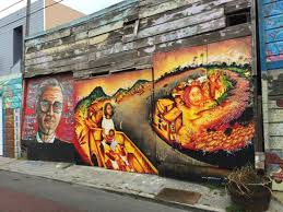 Balmy Alley Murals Mission District by No One Should Obey An Unjust Law 1996 And Past That Still Lives