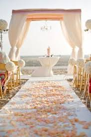 Petals In White Coral And Peach Sprinkled On Both Sides Of The Aisle Including Starfish USD 375